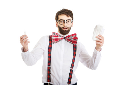 50080454 - surprised man wearing suspenders with menstruation pad.